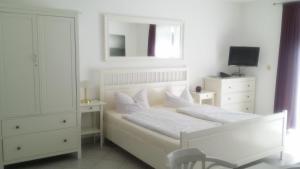 Familien- und Apparthotel Strandhof, Hotels  Tossens - big - 11