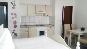 Familien- und Apparthotel Strandhof, Hotels  Tossens - big - 12