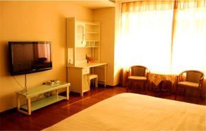 Tianjin Jinta International Xinyueyuan Hotel Apartment, Apartmány  Tianjin - big - 35