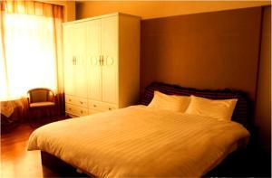 Tianjin Jinta International Xinyueyuan Hotel Apartment, Apartmány  Tianjin - big - 36