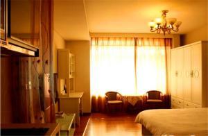 Tianjin Jinta International Xinyueyuan Hotel Apartment, Apartmány  Tianjin - big - 38