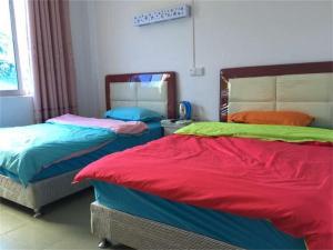 Zhanjiang Ouranjian Guesthouse, Hostelek  Csancsiang - big - 8