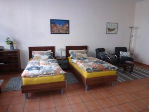 Häusser Apartment+Zimmer