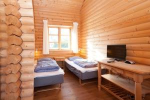 Ho Three-Bedroom Apartment 01, Ferienparks  Blåvand - big - 48