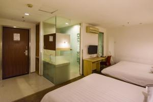 Motel Harbin Conference and Exhibition Centre Gongbin Road, Отели  Харбин - big - 24