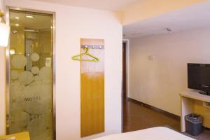 Motel Harbin Conference and Exhibition Centre Gongbin Road, Отели  Харбин - big - 6