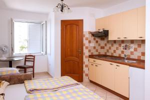 Apartments Villa Supertom, Ferienwohnungen  Povljana - big - 36