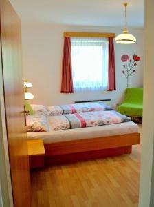 Ferienwohnungen Seerose direkt am See, Apartmány  Millstatt - big - 59