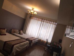Tianjin Jinta International Xinyueyuan Hotel Apartment, Apartmány  Tianjin - big - 2