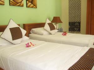 Guesthouse Rumah Senang, Гостевые дома  Kalibaru - big - 17