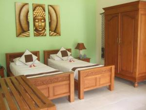 Guesthouse Rumah Senang, Гостевые дома  Kalibaru - big - 14