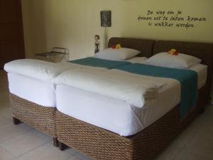 Guesthouse Rumah Senang, Гостевые дома  Kalibaru - big - 10