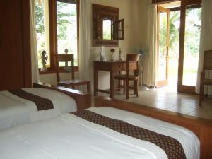 Guesthouse Rumah Senang, Гостевые дома  Kalibaru - big - 28
