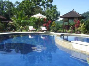 Guesthouse Rumah Senang, Гостевые дома  Kalibaru - big - 59