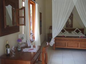 Guesthouse Rumah Senang, Гостевые дома  Kalibaru - big - 35