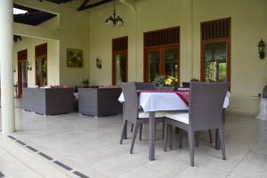 Guesthouse Rumah Senang, Гостевые дома  Kalibaru - big - 71