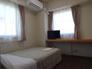 Ushiku City Hotel Ekimaekan, Отели эконом-класса  Ushiku - big - 6