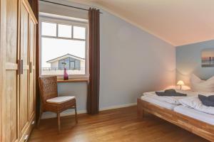 Ferienwohnungen Strandvilla Börgerende, Apartmány  Börgerende-Rethwisch - big - 48