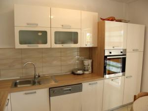 Apartment Slavica 2 IR7711, Апартаменты  Банёл - big - 24
