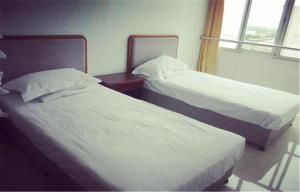 Huaxi Hotel, Alloggi in famiglia  Qinhuangdao - big - 5