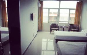 Huaxi Hotel, Alloggi in famiglia  Qinhuangdao - big - 4