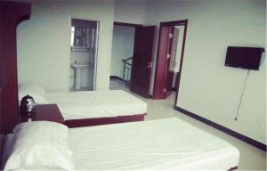 Huaxi Hotel, Homestays  Qinhuangdao - big - 8