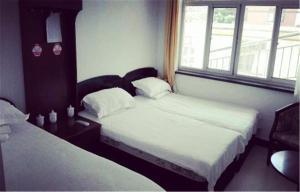 Huaxi Hotel, Alloggi in famiglia  Qinhuangdao - big - 18