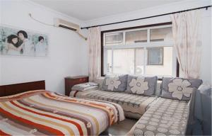 Xinghaige Guesthouse, Privatzimmer  Qinhuangdao - big - 5
