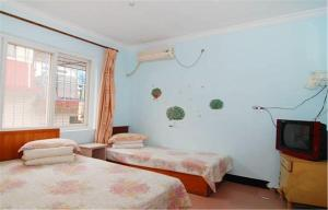 Xinghaige Guesthouse, Privatzimmer  Qinhuangdao - big - 6