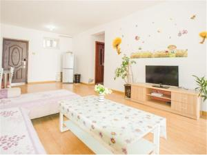 Qingdao Golden Beach Sihaiju Seaview Apartment Hai'an Fengqing Branch, Апартаменты  Huangdao - big - 5
