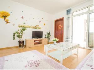 Qingdao Golden Beach Sihaiju Seaview Apartment Hai'an Fengqing Branch, Apartmány  Huangdao - big - 3