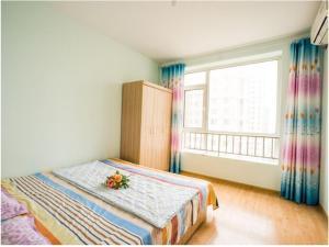 Qingdao Golden Beach Sihaiju Seaview Apartment Hai'an Fengqing Branch, Apartmány  Huangdao - big - 13