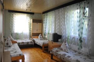Guest House U Tatyany, Guest houses  Malorechenskoye - big - 12