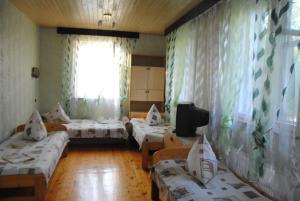 Guest House U Tatyany, Guest houses  Malorechenskoye - big - 11