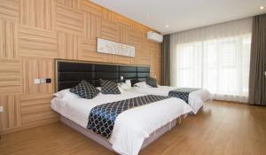 Qingdao Jinzuo Apartment Hotel