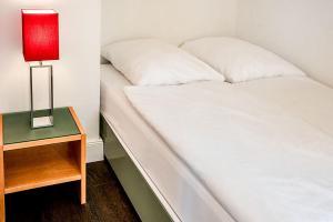 Dvoulůžkové studio typu Deluxe s manželskou postelí