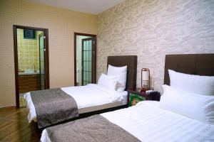 Garden Inn Beijing, Bed and Breakfasts  Peking - big - 12