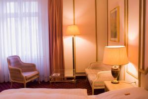 Dvoulůžkový pokoj typu Superior s manželskou postelí (2 dospělí a 2 děti)