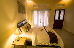 Umah Dajane Guest House, Affittacamere  Ubud - big - 9