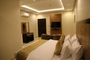 Mada Suites, Aparthotels  Riad - big - 16