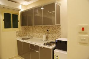 Mada Suites, Aparthotels  Riad - big - 9