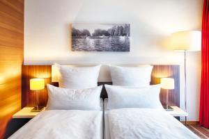 Dvoulůžkový pokoj typu Comfort s manželskou postelí nebo oddělenými postelemi