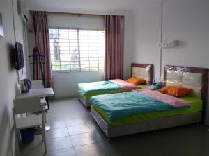 Zhanjiang Ouranjian Guesthouse, Hostelek  Csancsiang - big - 4