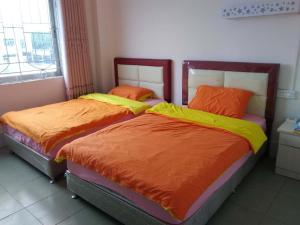Zhanjiang Ouranjian Guesthouse, Hostelek  Csancsiang - big - 5