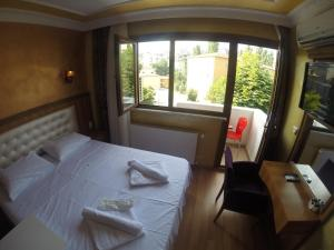 Arat Apartments, Апарт-отели  Стамбул - big - 115