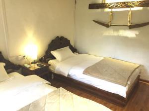 Lijiang Shuhe Qingtao Inn, Penziony  Lijiang - big - 39