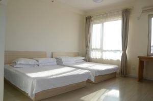 Gold Holiday Apartment, Ferienwohnungen  Jinzhou - big - 12
