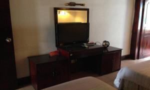 Gutong Bussiness Hotel Mianyang, Szállodák  Szantaj - big - 3
