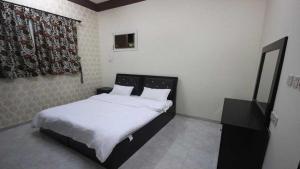 Afaq Al Elm Aparthotel, Апарт-отели  Унайза - big - 11