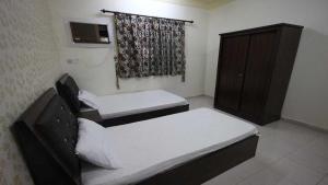 Afaq Al Elm Aparthotel, Апарт-отели  Унайза - big - 12